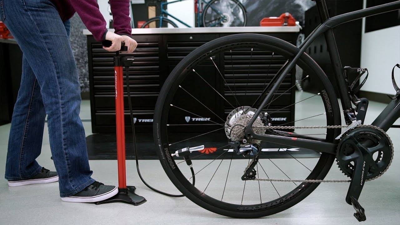 How should I pump air into bicycle tyres