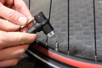 how to pump bike tire with ball pump